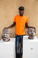 El Hadj Keita, Sculptor, and his Art Displayed inside the Fort d'Estrees, Biannual Arts Festival, Goree Island, Senegal.