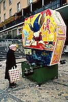 Switzerland. Basel. Fasnacht Carnival. An old woman looks at a luminous lantern. © 1997 Didier Ruef
