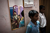 Orphans whose parents were the victims of the Naxalite insurgency seen at their orphanage in Dantewada in Chhattisgarh, India. Photo: Sanjit Das/Panos for The Times
