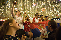 MOSCOW, RUSSIA - June 26, 2018: Russia fans pose and cheer for a photograph on Nikolskaya Street during the 2018 FIFA World Cup. The street was a crossroads for foreign soccer fans and local Russians during the World Cup in Russia.