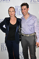 """TRACI LORDS & PAUL J. ALESSI, producer/actor.""""Knuckle Draggers"""" Premiere at the 2009 Newport Beach Film Festival held at Edwards Cinemas, Newport Beach, CA, USA..April 27th, 2009.half length black purple grey gray shirt trousers jacket tracey tracy blue silk satin hand on hip.CAP/ADM/BP.©Byron Purvis/AdMedia/Capital Pictures."""