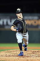 Omaha Storm Chasers pitcher Ryan Verdugo (7) delivers a warmup pitch during the second game of a double header against the Nashville Sounds on May 21, 2014 at Herschel Greer Stadium in Nashville, Tennessee.  Nashville defeated Omaha 13-4.  (Mike Janes/Four Seam Images)