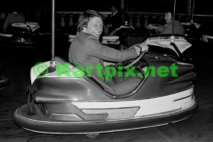 Roger Williamson enjoying all the fun of the fair prior to his Grand Prix debut at the1973 British Grand Prix.