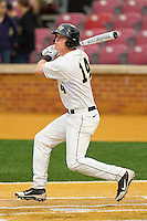 Conor Keniry #14 of the Wake Forest Demon Deacons follows through on his swing against the Florida State Seminoles at Wake Forest Baseball Park on March 24, 2012 in Winston-Salem, North Carolina.  The Seminoles defeated the Demon Deacons 3-2.  (Brian Westerholt/Four Seam Images)