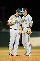 Coastal Carolina Chanticleers third baseman Zach Remillard (7) has a chat on the mound with starting pitcher Ben Smith (11) during the game against the High Point Panthers at Willard Stadium on March 14, 2014 in High Point, North Carolina.  The Panthers defeated the Chanticleers 3-0.  (Brian Westerholt/Four Seam Images)
