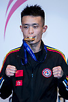 Liu Hin Chung of Hong Kong poses for photo with his gold metal in the prize presentation of the male muay 54KG division weight bout during in the East Asian Muaythai Championships 2017 at the Queen Elizabeth Stadium on 13 August 2017, in Hong Kong, China. Photo by Yu Chun Christopher Wong / Power Sport Images