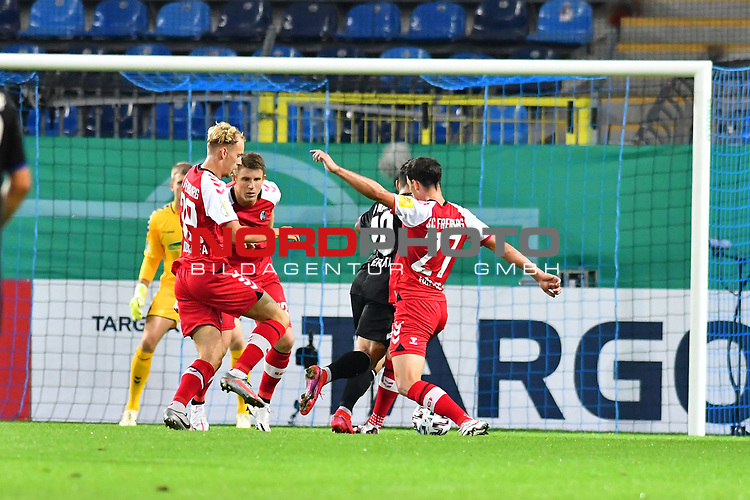 13.09.2020, Carl-Benz-Stadion, Mannheim, GER, DFB-Pokal, 1. Runde, SV Waldhof Mannheim vs. SC Freiburg, <br /> <br /> DFL REGULATIONS PROHIBIT ANY USE OF PHOTOGRAPHS AS IMAGE SEQUENCES AND/OR QUASI-VIDEO.<br /> <br /> im Bild: Arianit Ferati (SV Waldhof Mannheim #10) faellt im Strafraum gegen Nicolas Hoefler (#27, SC Freiburg)<br /> <br /> Foto © nordphoto / Fabisch