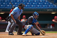 Catcher Cole Russo (33) of Tampa Jesuit HS in Tampa, FL playing for the San Francisco Giants scout team receives a pitch as home plate umpire Lance Weems looks on during the East Coast Pro Showcase at the Hoover Met Complex on August 5, 2020 in Hoover, AL. (Brian Westerholt/Four Seam Images)