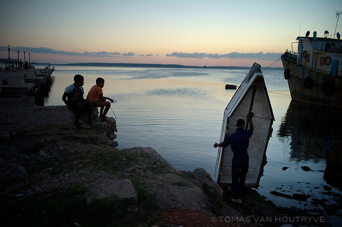 A fisherman pulls his makeshift fishing raft out of the water in Cienfuegos, Cuba on Nov. 10, 2010.