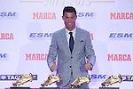 Real Madrid´s Cristiano Ronaldo poses with the 2014-15 Golden Boot award and the three previous awards in Madrid, Spain. October 13, 2015. (ALTERPHOTOS/Victor Blanco)