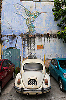 Ipoh, Malaysia.  Parked Car and Wall Painting.