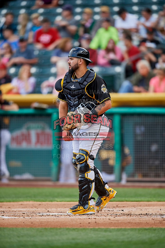 Juan Graterol (13) of the Salt Lake Bees on defense against the Sacramento River Cats at Smith's Ballpark on May 17, 2018 in Salt Lake City, Utah. Salt Lake defeated Sacramento 12-11. (Stephen Smith/Four Seam Images)