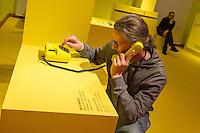 """Ausstellung """"Dialog mit der Zeit"""" im Museum fuer Kommunikation in Berlin-Mitte.<br /> Vom 1. April bis 23. August 2015 werden in der Ausstellung die Facetten des Alters und der Alterns erlebbar gemacht.<br /> Bundespraesident Joachim Gauck eroeffnete die Ausstellung am 31. Maerz 2015 mit einem Rundgang und einer Rede zu neuen Altersbildern in einer Gesellschaft des laengeren Lebens.<br /> Im Bild: Ausstellungbesucher koennen an sich selber testen wie schlecht im Alter Telefonate verstanden werden.<br /> 31.3.2015, Berlin<br /> Copyright: Christian-Ditsch.de<br /> [Inhaltsveraendernde Manipulation des Fotos nur nach ausdruecklicher Genehmigung des Fotografen. Vereinbarungen ueber Abtretung von Persoenlichkeitsrechten/Model Release der abgebildeten Person/Personen liegen nicht vor. NO MODEL RELEASE! Nur fuer Redaktionelle Zwecke. Don't publish without copyright Christian-Ditsch.de, Veroeffentlichung nur mit Fotografennennung, sowie gegen Honorar, MwSt. und Beleg. Konto: I N G - D i B a, IBAN DE58500105175400192269, BIC INGDDEFFXXX, Kontakt: post@christian-ditsch.de<br /> Bei der Bearbeitung der Dateiinformationen darf die Urheberkennzeichnung in den EXIF- und  IPTC-Daten nicht entfernt werden, diese sind in digitalen Medien nach §95c UrhG rechtlich geschuetzt. Der Urhebervermerk wird gemaess §13 UrhG verlangt.]"""