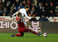 Wednesday, 12 December 2012<br /> Pictured: Michu of Swansea (R) takes a shot off target during a tackle by Seb Hines of Middlesbrough (L)<br /> Re: Capital One Cup, fifth round, Swansea City FC v Middlesbrough at the Liberty Stadium, south Wales.