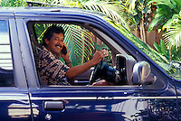 Honolulu businessman talking on cellular phone in car