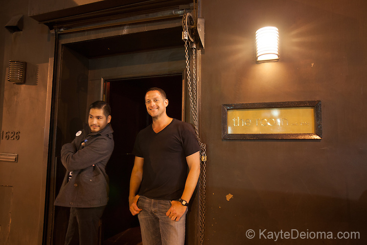 Two men in front of The Room bar on Caheunga Blvd in Hollywood, Los Angeles, CA
