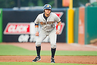 Dante Bichette Jr. (19) of the Charleston RiverDogs takes his lead off of first base against the Greensboro Grasshoppers at NewBridge Bank Park on July 17, 2013 in Greensboro, North Carolina.  The Grasshoppers defeated the RiverDogs 4-3.  (Brian Westerholt/Four Seam Images)