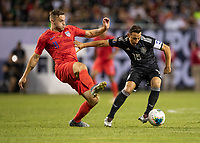 CHICAGO, IL - JULY 7: Jordan Morris #11 defends against Andres Guardado #18 during a game between Mexico and USMNT at Soldiers Field on July 7, 2019 in Chicago, Illinois.