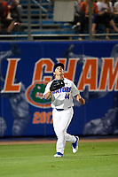 Florida Gators left fielder Austin Langworthy (44) tracks a fly ball during a game against the Siena Saints on February 16, 2018 at Alfred A. McKethan Stadium in Gainesville, Florida.  Florida defeated Siena 7-1.  (Mike Janes/Four Seam Images)