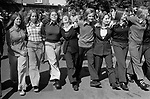 Teenage girls arms linked together having fun, looking stylish 1970s fashion conscious at the Durham Coal Miners annual gala  County Durham UK