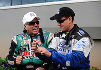 Sept. 18, 2011; Concord, NC, USA: NHRA funny car driver Bob Tasca III (right) talks with John Force during the O'Reilly Auto Parts Nationals at zMax Dragway. Mandatory Credit: Mark J. Rebilas-