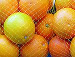 Bag of oranges at the market.