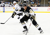 Beau Bennett #19 of the Pittsburgh Penguins in action against the Los Angeles Kings during the game at Consol Energy Center in Pittsburgh, Pennsylvania on December 11, 2015. (Photo by Jared Wickerham / DKPS)