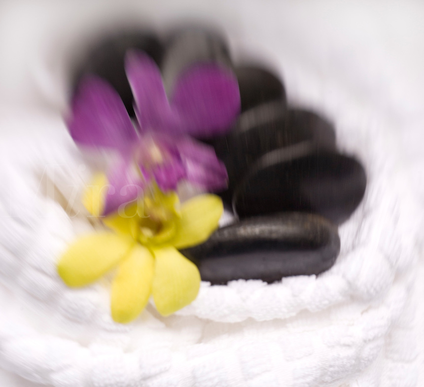 Black Massage Stones on white Towel<br />