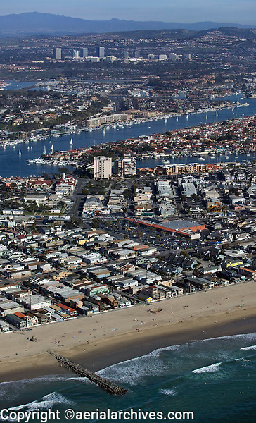 aerial photograph Newport Beach toward Costa Mesa, Orange County, California; 39th St Jetty, Lido Isle in the middle ground, Costa Mesa in the backvground.