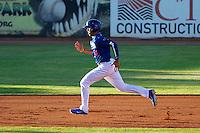 Ogden Raptors third baseman Alex Santana #21 hustles towards third base against the Grand Junction Rockies at Lindquist Field on June 27, 2013 in Ogden, Utah. (Stephen Smith/Four Seam Images)