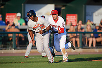 Harrisburg Senators third baseman Drew Ward (17) chases Aderlin Rodriguez (34) in a run down during a game against the Bowie Baysox on May 16, 2017 at FNB Field in Harrisburg, Pennsylvania.  Bowie defeated Harrisburg 6-4.  (Mike Janes/Four Seam Images)