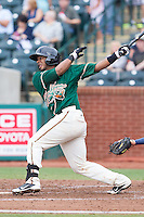 Joel Jimenez (39) of the Greensboro Grasshoppers follows through on his swing against the Hagerstown Suns at NewBridge Bank Park on May 20, 2014 in Greensboro, North Carolina.  The Grasshoppers defeated the Suns 5-4. (Brian Westerholt/Four Seam Images)