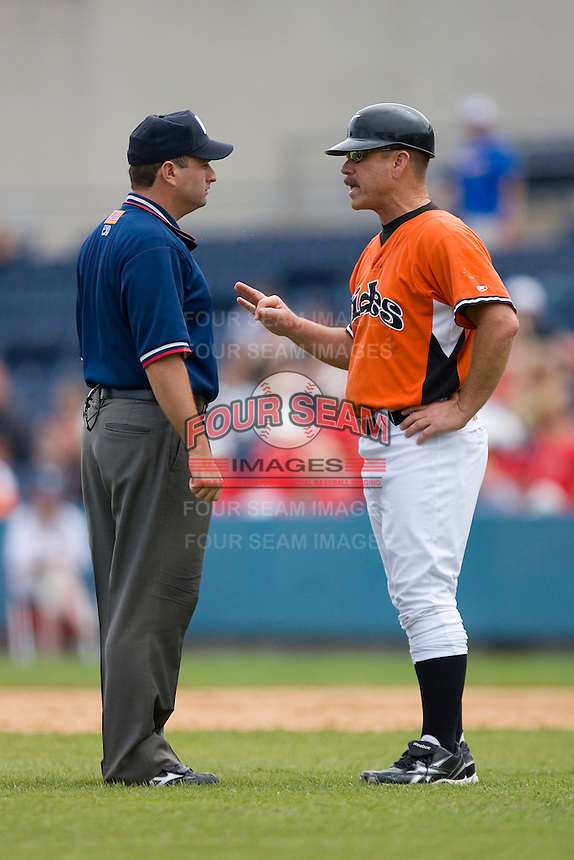Norfolk Tides manager Gary Allenson #6 argues a call with first base umpire Jason Klein during an International League game at Harbor Park June 7, 2009 in Norfolk, Virginia. (Photo by Brian Westerholt / Four Seam Images)