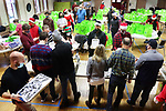 NAUGATUCK CT. - 25 December 2020-122520SV02-About 75 volunteers fill bags with Christmas dinner to be delivers to familys in need at St. Michaels Church in Naugatuck Friday.<br /> Steven Valenti Republican-American