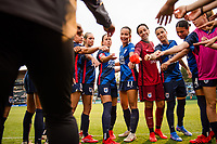 TACOMA, WA - JULY 31: OL Reign huddle together before a game between Racing Louisville FC and OL Reign at Cheney Stadium on July 31, 2021 in Tacoma, Washington.