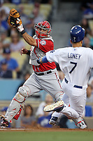 Washington Nationals catcher Wilson Ramos #3 prepares to tag Los Angeles Dodgers first baseman James Loney #7 during a game at Dodger Stadium on July 23, 2011 in Los Angeles,California. Los Angeles defeated Washington 7-6.(Larry Goren/Four Seam Images)