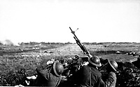 Anti-aircraft machine gun of 101st Field Artillery (formerly 1st Massachusetts F.A., New England Coast Artillery), firing on a German observation plane at Plateau Chemin des Dames, France.  March 5, 1918.  Lt. Edwin H. Cooper. (Army)<br /> NARA FILE #:  111-SC-8716<br /> WAR & CONFLICT BOOK #:  622