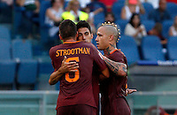 Calcio, Serie A: Roma vs Udinese. Roma, stadio Olimpico, 20 agosto 2016.<br /> Roma's Diego Perotti, center, celebrates with teammates Kevin Strootman, left, and Radja Nainggolan, after scoring his second goal on a penalty kick during the Italian Serie A football match between Roma and Udinese at Rome's Olympic Stadium, 20 August 2016. Roma won 4-0.<br /> UPDATE IMAGES PRESS/Riccardo De Luca