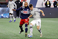 20th November 2020; Foxborough, MA, USA;  Montreal Impact midfielder Amarettos Sejdic plays the ball away from New England Revolution midfielder Teal Bunbury (10) during the MLS Cup Play-In game between the New England Revolution and the Montreal Impact