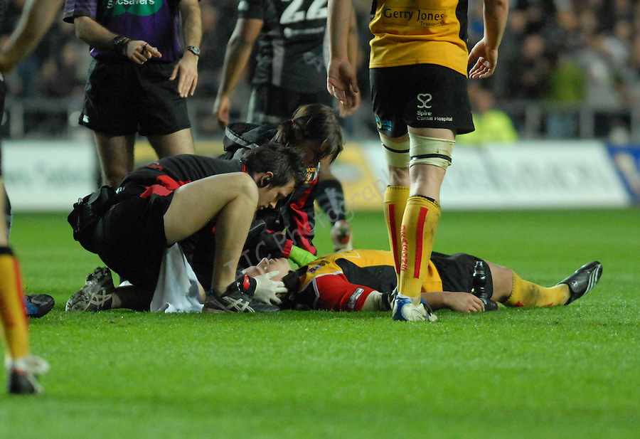 Rhodri Gomer-Davies being treated for a potentially serious neck injury Swansea Neath Ospreys Vs Newport Gwent Dragons, Magners league, Liberty Stadium © IJC Photography. Photographer Ian Cook