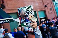 BOSTON, MASS. - SEPT. 28, 2014: Joe Rutledge of Boston sells programs and penants commemorating Derek Jeter and the Red Sox Yankees rivalry to fans at Fenway Park before the New York Yankees and Boston Red Sox play at Fenway Park. The game is last game of Derek Jeter's career. M. Scott Brauer for The New York Times