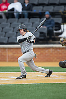 Chandler Seagle (5) of the Appalachian State Mountaineers follows through on his swing against the Wake Forest Demon Deacons at Wake Forest Baseball Park on February 13, 2015 in Winston-Salem, North Carolina.  The Mountaineers defeated the Demon Deacons 10-1.  (Brian Westerholt/Four Seam Images)