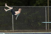 Kaleb Fusilier, 13, floats between rain showers from the diving board at Meade Pool Monday in Charlottesville, Va. The pool is open weekdays from 12-6pm and weekends from 12-5pm and costs charlottesville residents $.75 for children and $3.00 for adults. Photo//Andrew Shurtleff  swim dive pool fun
