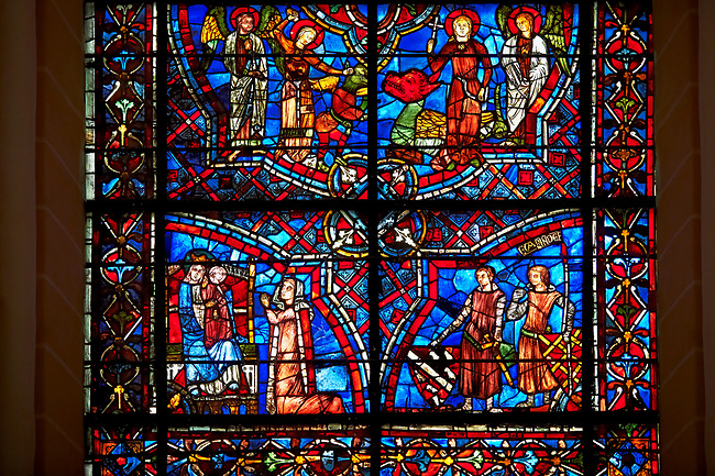 Medieval stained glass Window of the Gothic Cathedral of Chartres, France - dedicated to St Margret and St Catherine. Bottom left panel -  Margaret of Lèves praying before statue of the Virgin & Child, bottom right - Donors of the window  Geffroy de Meslay and Guerin de Fraize. Top left panel - St Margaret vanquishing a demon, top right panel - St Margaret bursting out of the belly of a dragon . A UNESCO World Heritage Site.