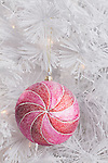 USA, Illinois, Metamora, pink Christmas bauble on white Christmas tree, close-up