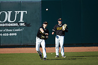 West Virginia State Yellow Jackets left fielder Matthew Kline (8) throws the ball back to the infield as center fielder Andrew Stone (9) looks on during the game against the Catawba Indians at Newman Park on February 9, 2020 in Salisbury, North Carolina. The Indians defeated the Yellow Jackets 15-9 in game one of a doubleheader.  (Brian Westerholt/Four Seam Images)