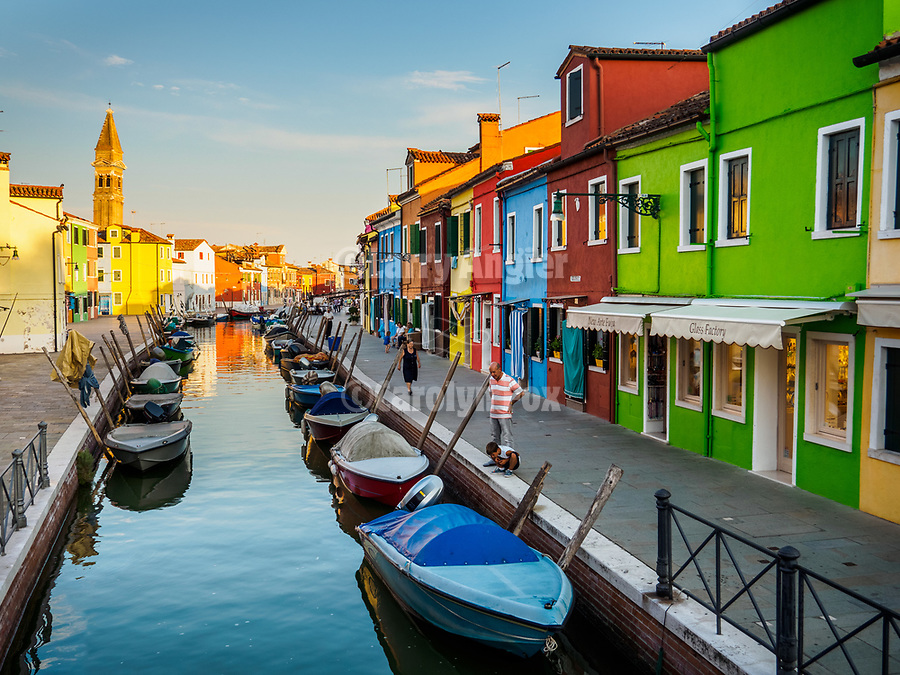 Leaning Bell Tower of St. Martin Bishop, colorful village of Burano, Italy.