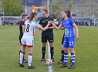 Captain Lenie Onzia (8) of OHL gives a fist bump to captain Silke Vanwynsberghe (21) of AA Gent before a female soccer game between  AA Gent Ladies and Oud Heverlee Leuven on the fourth matchday of play off 1 in the 2020 - 2021 season of Belgian Scooore Womens Super League , saturday 1 st of May 2021  in Oostakker , Belgium . PHOTO SPORTPIX.BE | SPP | STIJN AUDOOREN