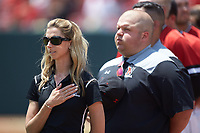 Northeastern Huskies athletic trainer Krystin Ojala (left) stands for the National Anthem prior to the game against the North Carolina State Wolfpack at Doak Field at Dail Park on June 2, 2018 in Raleigh, North Carolina. The Wolfpack defeated the Huskies 9-2. (Brian Westerholt/Four Seam Images)