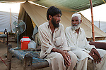 Nazir Khan with his father Zertamin from Buner at the Chota Lahore refugee camp in Swabi district, Pakistan. Conditions in the camp are steadily worsening despite a third of the population leaving to return home with the Taliban being pushed back by the army. Ration, wood, water and medical shortages are contributing to increasing frustration of the remaining residents and tensions are rising.